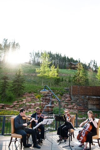 string-quartet-musicians-playing-at-big-sky-montana-wedding-ceremony