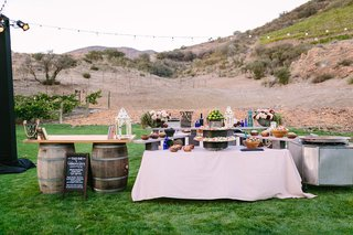 taco-bar-set-up-outdoors-faux-wedding-party-styled-shoot-rustic-event-farmhouse-lawn-barrels-food