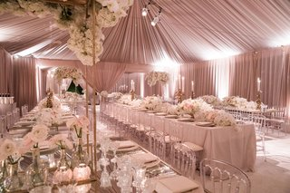 pink-tent-wedding-reception-long-tables-clear-chairs-white-flowers-high-low-centerpieces