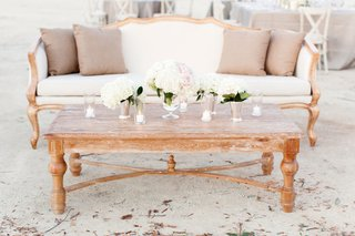 wedding-lounge-with-wood-table-and-white-sofa