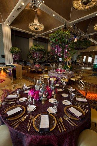 purple-reception-decor-cascading-flowers-bold-floral-arrangement