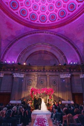 weylin-b-seymours-wedding-ceremony-under-dome-with-flower-embellished-ceremony-structure