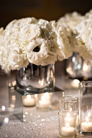 small-white-flower-centerpiece-on-mirror-cube-with-sequin-table-linen