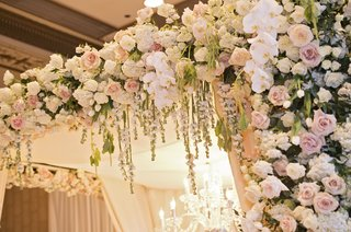blush-and-ivory-roses-and-white-orchids-on-floral-chuppah