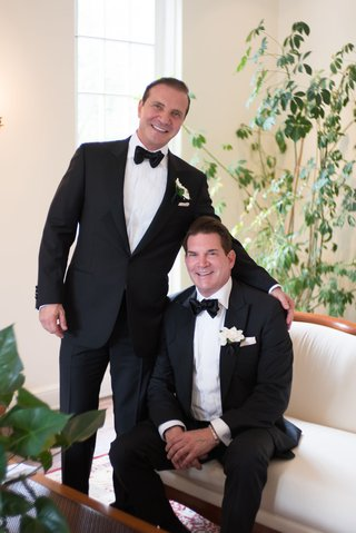 groom-and-groom-in-tuxedos-with-bow-ties-and-ivory-boutonnieres-san-diego-wedding-gay-wedding