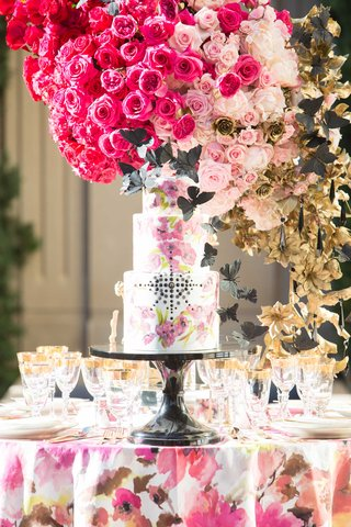 white-cake-with-pink-flower-design-and-black-jewels-black-butterflies-pink-floral-linen-centerpiece