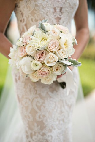 bride-in-ines-di-santo-wedding-dress-holding-bouquet-with-pink-and-white-rose-flowers-peony-dahlia
