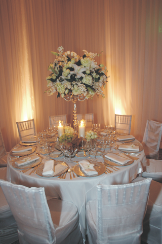 round-tables-with-white-flower-candelabra