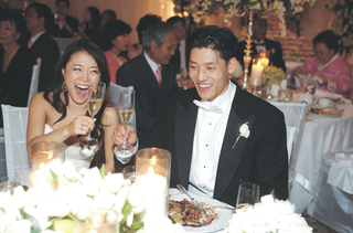 asian-american-couple-toasting-at-reception