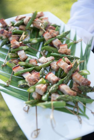 garden-wedding-reception-cocktail-hour-with-tray-of-pork-asparagus-appetizers