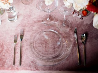place-setting-wedding-reception-clear-charger-plate-and-silver-flatware-pink-velvet-linens-reception