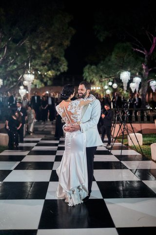 bride-and-groom-first-dance-on-black-and-white-checkered-dance-floor