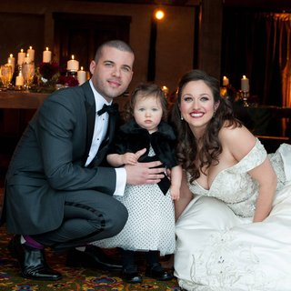 bride-and-groom-with-young-daughter-in-polka-dots