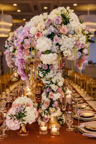 wedding-table-candles-gold-riser-with-white-purple-pink-flowers-rose-hydrangea-greenery-orchid