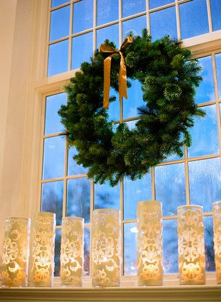 christmas-wreath-and-laser-cut-candles-at-wedding