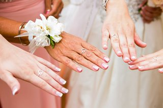 heart-shaped-ring-worn-by-bride-mother-of-the-bride-and-sisters-bridesmaid-maid-of-honor