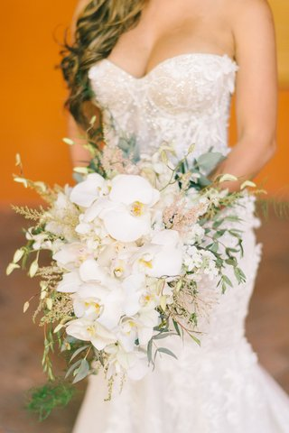 bride-in-strapless-dress-long-ponytail-bouquet-with-white-phalaenopsis-orchids-greenery-pink-astilbe