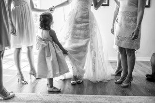 flower-girl-helping-bride-getting-ready-in-la-jolla-ca