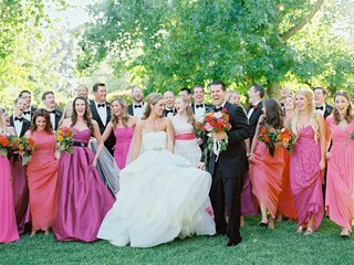 bride-in-vera-wang-wedding-dress-with-groom-in-tuxedo-and-bridesmaids-in-pink-and-orange-dresses