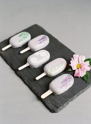 wedding-event-dessert-ideas-ice-pop-ice-cream-bar-lavender-hand-painted-design-on-slate-tray-pink