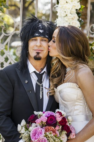 bride-kissing-motley-crue-groom-on-cheek