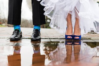 groom-with-blue-green-argyle-socks-black-shoes-bride-with-dark-blue-badgley-mischka-pumps