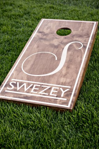 wedding-reception-cocktail-hour-games-corn-hole-custom-board-with-monogram-and-last-name