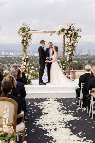 rooftop-wedding-ceremony-los-angeles-city-view-rustic-birch-bark-arch-pink-flowers-greenery
