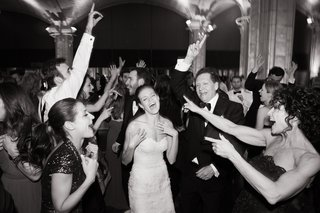 black-and-white-photo-of-bride-and-her-family-dancing-and-singing-at-the-reception