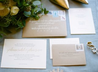 wedding-invitation-white-with-gold-details-and-kraft-paper-envelopes-calligraphy-stamps