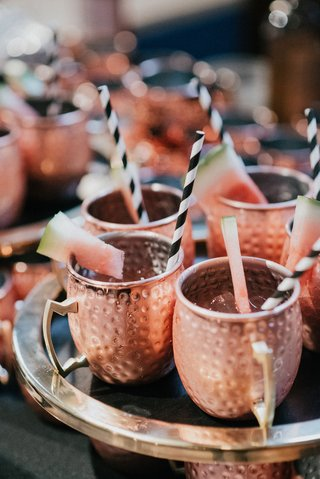 wedding-cocktail-hour-drinks-moscow-mule-copper-mug-with-black-white-stripe-straw-watermelon-garnish
