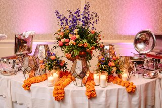 geometric-mercury-lanterns-vibrant-florals-in-vase-marigold-sangeet-indian-reception