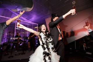 bride-with-black-and-white-boa-groom-in-novelty-top-hat-new-years-eve-wedding