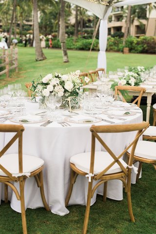 wedding-reception-round-white-table-tent-wedding-low-centerpiece-greenery-vineyard-wood-chair-white