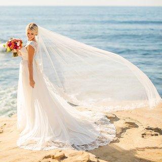 veil-flowing-wind-bride-rocks-over-ocean-seaside-chapel-length-la-jolla-california-wedding
