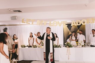 irish-catholic-priest-giving-a-blessing-for-wedding-reception-dinner