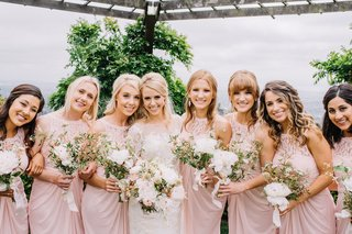 bride-with-seven-bridesmaids-in-light-pink-bridesmaid-dresses