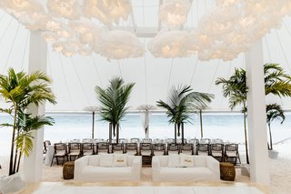 tent-wedding-on-beach-paper-lantern-green-palm-tree-decor-white-slipcover-sofa-lounge