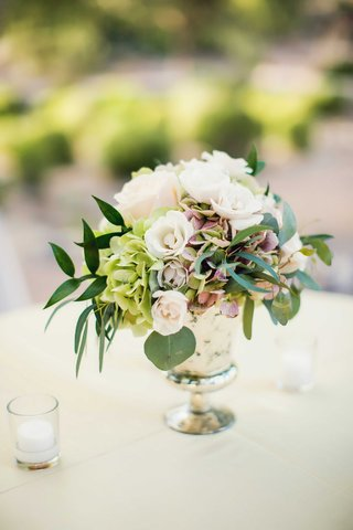 silver-mercury-glass-vessel-with-green-leaves-green-hydrangea-pink-hydrangea-white-spray-rose