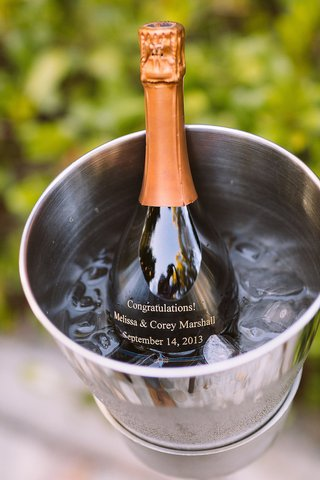 champagne-bottle-with-a-congratulations-message-for-bride-and-groom-in-ice-bucket