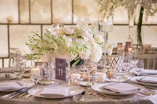 low-white-floral-arrangement-greenery-accents-table-number-silver-new-york-wedding-reception