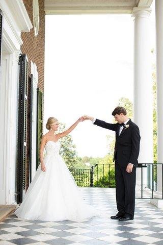 bride-and-groom-first-look-on-checkered-patio-floor