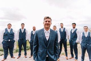 groom-and-groomsmen-in-3-piece-navy-blue-suits