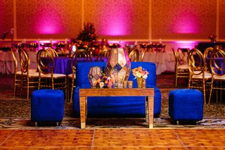 sangeet-reception-party-bright-blue-furniture-for-couple-to-watch-performances