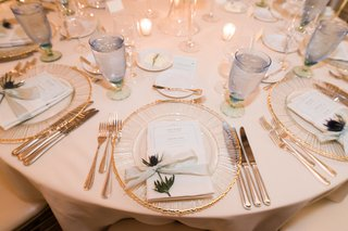 sprig-of-thistle-at-each-wedding-place-setting-textured-charger-with-gold-rim-pale-blue-cups