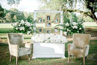 wedding-reception-cocktail-hour-white-box-white-hydrangea-velvet-armchair-white-frame-gold-frames