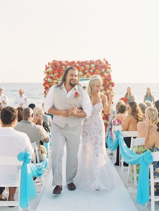 cj-lana-perry-and-miroslav-rusev-barnyashev-walking-up-white-aisle-wedding-ceremony-beach-malibu
