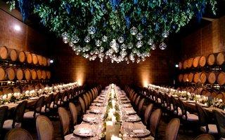 green-vine-and-grape-chandelier-in-barrel-room-wedding-reception