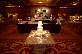 white-cake-on-ballroom-stand-with-flower-petals