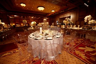 ghost-chairs-around-round-wedding-reception-table